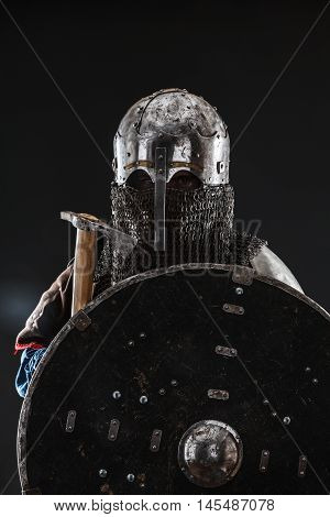 Mongol horde warrior in armour holding traditional axe