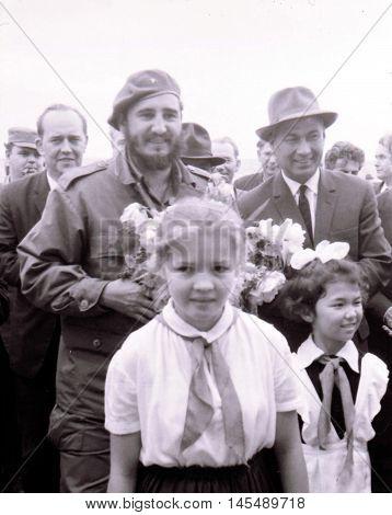 Yangiyer Uzbekistan - May 10 1963: Fidel Castro Ruz Sharaf Rashidov and pioneer girls.