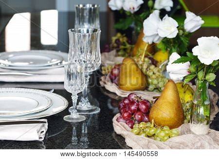 Thanksgiving table setting. Autumn table setting decorated fresh fruits and flowers