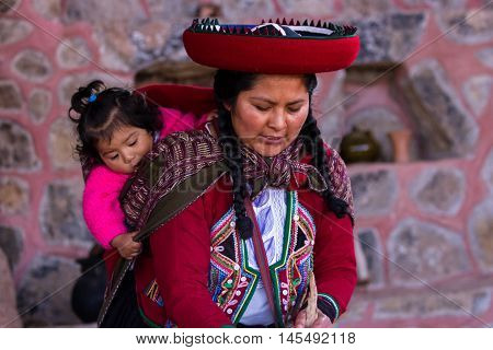 Weaver Woman With Her Baby In Chinchero