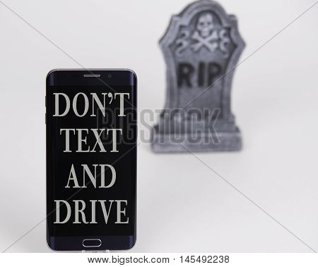 Dont text and drive phone with headstone, and white background