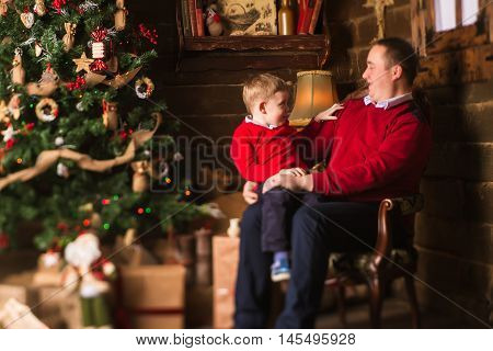 Young Father And Son Celebrating Christmas At Home