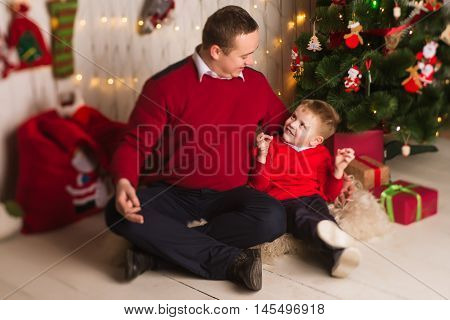 Young Happy Father And Son Celebrating Christmas At Home