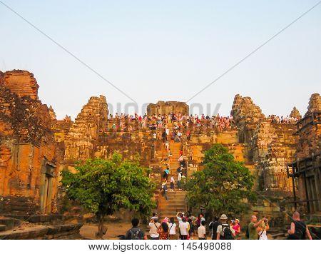 Angkor Wat, Cambodia - February 17, 2011: The tourists coming to watch beautiful orange sunrise in Angkor Wat, Siem Reap Cambodia