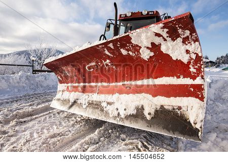 Big paddle of snow plow machine on snowy road