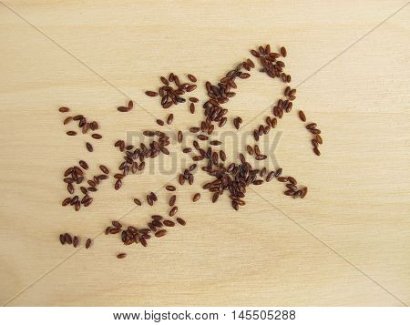 Psyllium seeds, Psyllii semen, on wooden board