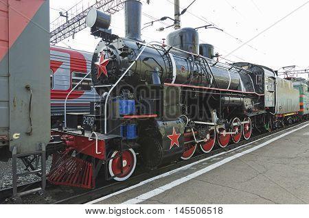 Ulan-ude, Russia - July, 16 2014: Old Vintage Steam Locomotive Ea Series On The Platform Of Ulan-ude