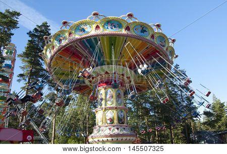 Kouvola, Finland 1 July 2015 - Ride Swing Carousel In Motion In Amusement Park Tykkimaki