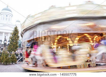 Helsinki, Finland 21 December 2015 - Traditional Carousel At Christmas Market On Senat Square In Mot
