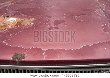 Close up of cracked and peeling paint of an old car