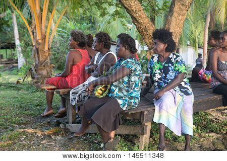 Chea Village, Solomon Islands - June 05, 2015: Women sitting under a tree at the small local market