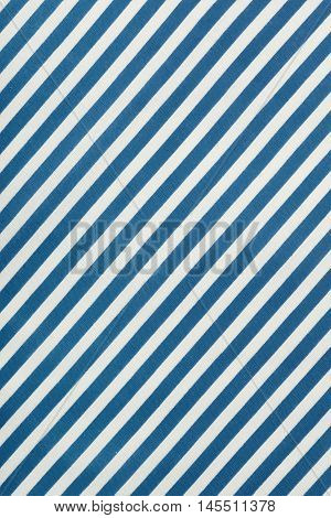 Fabric background in diagonal blue and white stripe, cotton texture, top view.