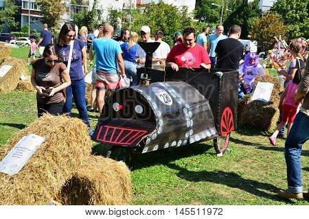 CLUJ-NAPOCA ROMANIA - SEPTEMBER 3 2016: People admiring the race mobils outdoors at the Red Bull Soapbox Race