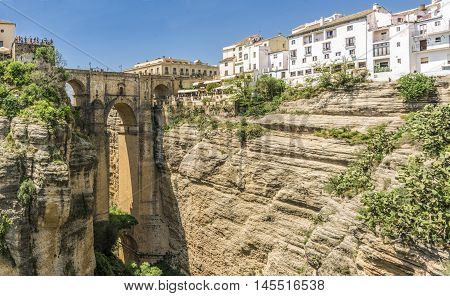 The Puente Nuevo bridge divides the city of Ronda, in Andalucia , southern Spain. It is a stone bridge with 120 meters high .