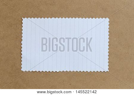 vintage of cardboard on brown background and copy specs you can input text to it.