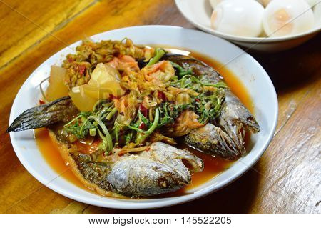 deep fried striped snake head fish in mixed hot and sour soup eat with boiled egg