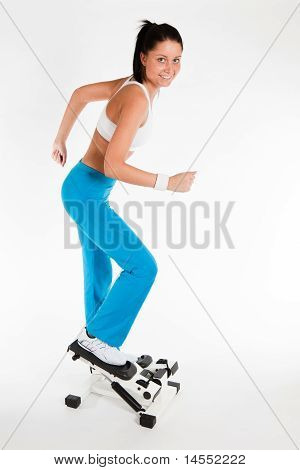 Woman Working Out On Stepper Trainer