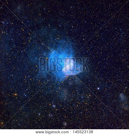 NGC 346 is an open cluster with associated nebula located in the Small Magellanic Cloud that appears in the constellation Tucana. Retouched image. Elements of this image furnished by NASA.