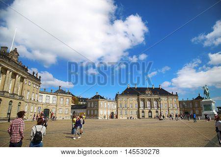 Copenhagen Denmark - August 15 2016: Sculpture of Frederik V on Horseback in Amalienborg Square it's home of the Danish Royal family in Copenhagen Denmark