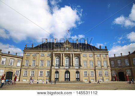 Copenhagen Denmark - August 15 2016: Amalienborg Square with tourist it's home of the Danish Royal family in Copenhagen Denmark