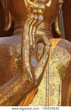 Gold Buddha statue (Luang por shin pa tan porn) in Thailand temple at Kanchanaburi temple (Wat Tham Sua).