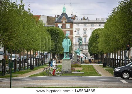 Copenhagen Denmark - August 15 2016: View on park and Statue of Carl Frederik Tietgen in Toldbodgade street which is located near Nyhavn harbor in Copenhagen Denmark