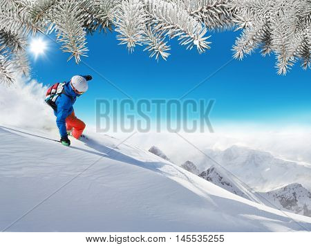 Skier on piste running downhill in beautiful Alpine landscape. Snowy fir branches on background. Free space for text