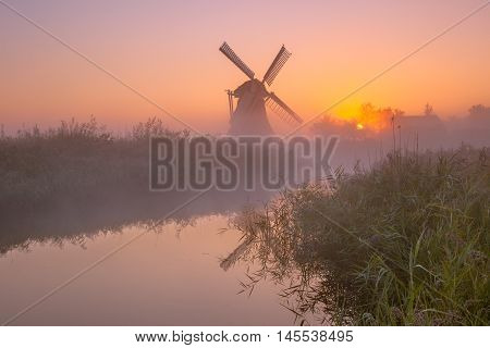 Historic Windmill Along A River