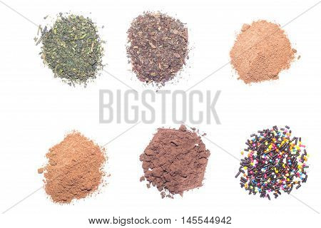 the cocoa powder ground coffee and dried tea leaves in a white container over white background.