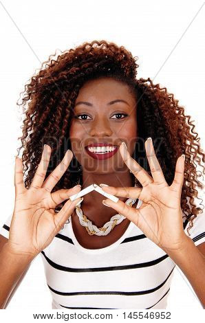 A happy African American woman holding a cigarette and breaking it no more smoking isolated for white background.