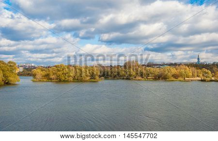 Urban autumn landscape bank of the river