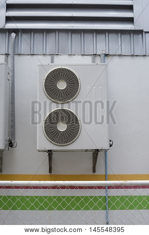 Portrait Of Air Conditioner Units On Wall Outside Building.
