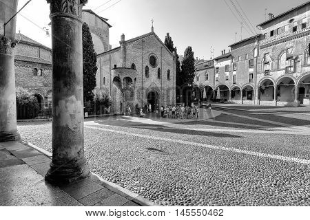 Bologna Italy -September 04 2016.Group of tourists in front of the Catholic church in the historic Piazza Santo Stefano in Bologna Italy