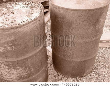 Junkyard rusty details - old fuel churns