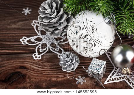 Christmas balls with decoration and firtree on old wooden board holiday greeting card