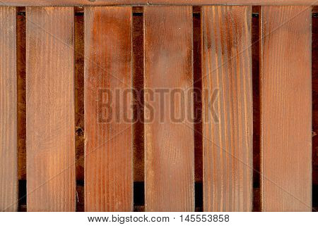 Trimmed wooden baseboard paneling background with vertical strips