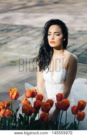 Pretty Wedding Woman Near Red Tulips