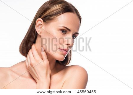 Skincare. Wistful beautiful young woman face close up studio portrait on isolated white background