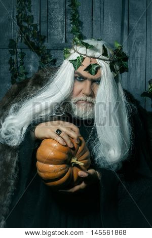 Man In Costume Of Sorcerer