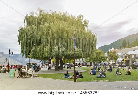 Queenstown New Zealand - March 2016: Queenstown waterfront by Lake Wakatipu New Zealand