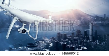 Photo White Matte Generic Design Remote Control Air Drone with action camera Flying Sky under City. Modern Megapolis Background. Wide, front side view. Motion Blur Effect. 3D rendering