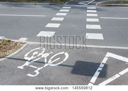 Bicycle road sign on asphalt.Bicycle road sign and bike rider. Crossing the road. Cartoons traffic signs.