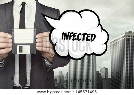 Infected text on speech bubble with businessman holding diskette