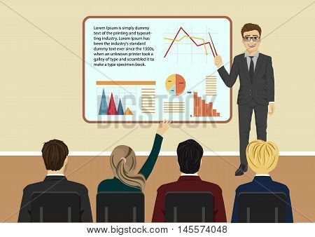 Young businessman giving a presentation to some of his clients in a meeting room
