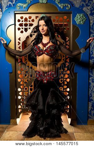 Beautiful Belly Dancer Young Woman In Gorgeous Red And Black Costume Dress. Beautiful Brunette With
