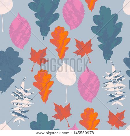 Floral seamless pattern with autumn grunge blue red orange white pink tree leaves on pastel blue background. Maple Elm Oak Aspen textured leaves. Vector illustration.