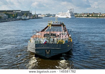 Big cargo ship floats on the river.