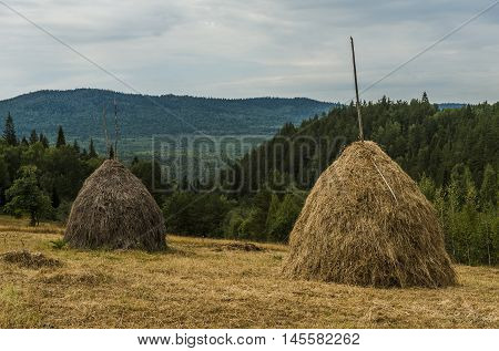 Republic of Bashkortostan Russia. Haystacks in the mountains of the Southern Urals.