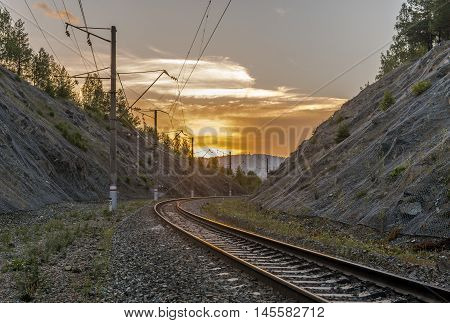 Republic of Bashkortostan Russia. Railway in the Ural mountains at sunset.