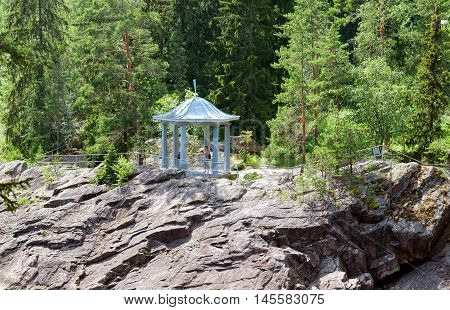 IMATRA, FINLAND - JULY 2, 2016: People take pictures in the pavilion in front of the canyon of Imatrankoski (The Imatra Rapid) on The Vuoksi River.